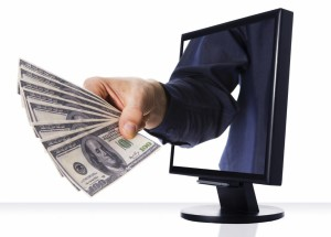 a computer flat screen monitor with money